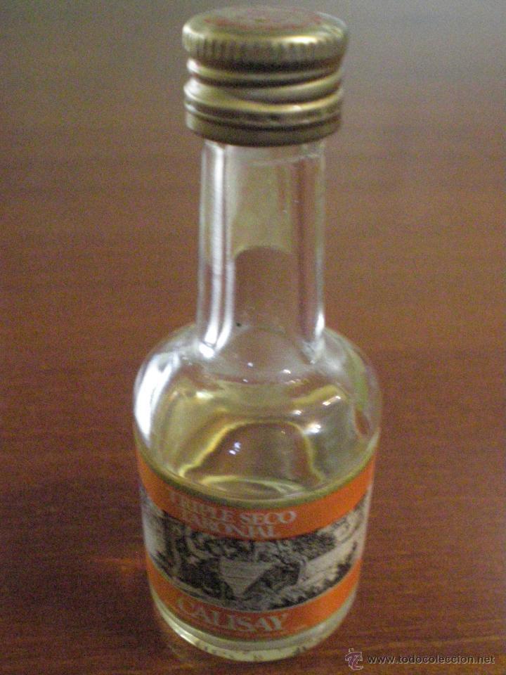 CALISAY. TRIPLE SECO TARONJAL. ANTIGUA PEQUEÑA BOTELLA CRISTAL. SELLO FISCAL IMPUESTO ALCOHOL 50 CTS (Coleccionismo - Botellas y Bebidas - Vinos, Licores y Aguardientes)