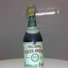 Coleccionismo de vinos y licores: BOTELLA ANTIGUA DE BRANDY TRES COPAS 3 GONZALEZ BYASS JEREZ PRECINTO IMPUESTO SELLO DE 80 CENTIMOS . Lote 47807301