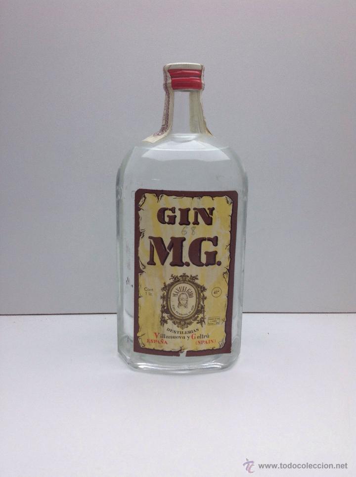 RARA BOTELLA DE GINEBRA GIN M.G.PRECINTO 80 CTS DESTILERIAS MANUEL GIRO (Coleccionismo - Botellas y Bebidas - Vinos, Licores y Aguardientes)