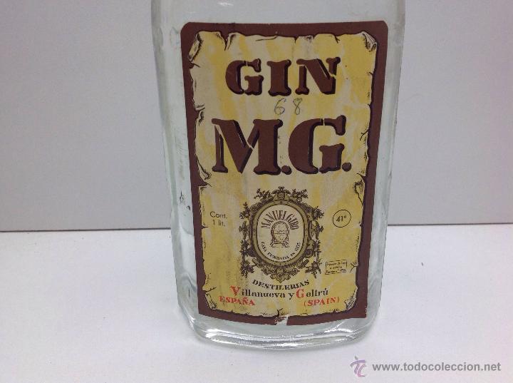 Coleccionismo de vinos y licores: RARA BOTELLA DE GINEBRA GIN M.G.PRECINTO 80 CTS DESTILERIAS MANUEL GIRO - Foto 4 - 167642126
