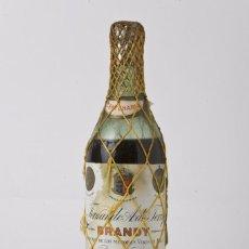 Coleccionismo de vinos y licores: ANTIGUA BOTELLA DE BRANDY TERRY CENTENARIO, MAYA AMARILLA. PRECINTO 80 CENTIMOS. Lote 55692425