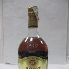 Coleccionismo de vinos y licores: BOTELLA DE BRANDY DE JEREZ. 1877. SOLERA RESERVA. WILLIAMS & HUMBERT. 23,5 CM DE ALTO.. Lote 60292523