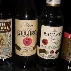 Coleccionismo de vinos y licores: BOTELLINES DE RON (4) DE DISTINTAS DEST.:GUAJIRO (VACÍA), BACARDÍ, SAINT GUILLES, BOTH ADMIRAL . Lote 105052247