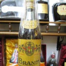 Coleccionismo de vinos y licores: ANTIGUA BOTELLA BRANDY COÑAC, ROGES SOLERA VIEJA IMPUESTO DE 4 PTS, DECADA 60-70. Lote 107834415