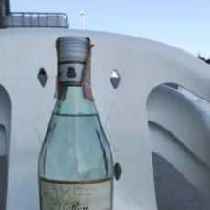 Coleccionismo de vinos y licores: ANTIGUA BOTELLA DE RON BOUNTY. Lote 120551051
