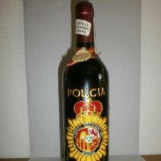 Coleccionismo de vinos y licores: BOTELLA DE VINO DECORADA A MANO CON EL ESCUDO DE POLICIA NACIONAL. Lote 121853683
