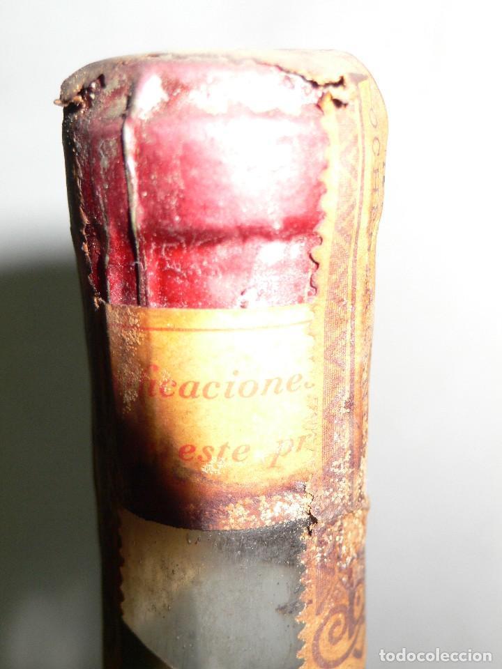Coleccionismo de vinos y licores: ANTIGUA BOTELLA DE BRANDY (COÑAC) ESCARCHADO E.J.ESCAT - Foto 10 - 122120735