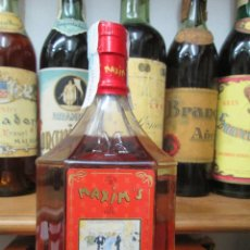 Coleccionismo de vinos y licores: ANTIGUA BOTELLA BRANDY COÑAC MAXIM'S X.O. ESPECIAL PARIS.. Lote 125823939