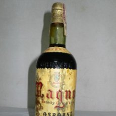 Coleccionismo de vinos y licores: ANTIGUA BOTELLA BRANDY EXTRA VIEJO MAGNO DE OSBORNE. Lote 126047895