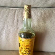 Coleccionismo de vinos y licores: BOTELLA CARLOS I SOLERA ESPECIAL PEDRO DOMEQ. PRECINTO 4 PTAS A ESTRENAR. Lote 128750119