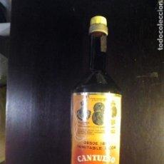 Coleccionismo de vinos y licores: BOTELLA LICOR CANTUESO ORO. Lote 129660134