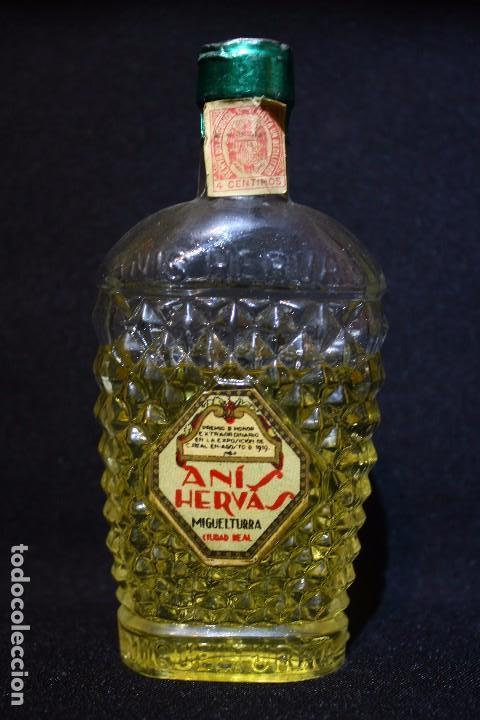 BOTELLIN ANIS HERVAS-MIGUELTURRA-CIUDAD REAL (Coleccionismo - Botellas y Bebidas - Vinos, Licores y Aguardientes)