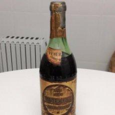 Coleccionismo de vinos y licores: BOTELLA BRANDY COÑAC VENERABLE DE JOSE DE SOTO JEREZ LETRAS EN RELIEVE PRECINTO 80 CENTIMOS RARA. Lote 150078018