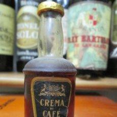 Coleccionismo de vinos y licores: ANTIGUO BOTELLIN BRANDY COÑAC, CREMADE CAFE 10 CM. Lote 168959492
