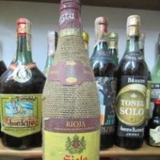 Coleccionismo de vinos y licores: ANTIGUA BOTELLA VINO SIGLO, VINO TINTO RESERVA DE RIOJA COSECHA 1973. Lote 173072259