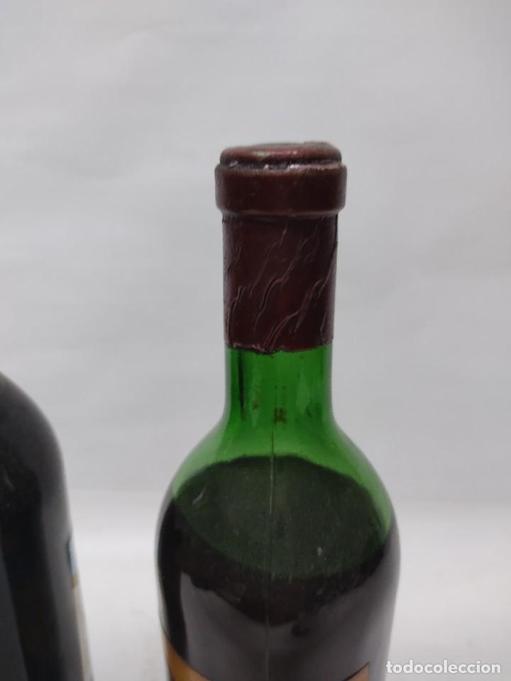 Coleccionismo de vinos y licores: ANTIGUAS DOS BOTELLAS VINO. RIOJA. FEDERICO PATERNINA. OLLAURI. SIN ABRIR - Foto 7 - 253143200