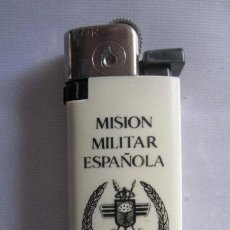 Coleccionismo: INTERESANTE MECHERO 1ª MISION MILITAR ESPAÑOLA EN GUINEA ECUATORIAL.......UNICO........ (ANTIGUOS). Lote 64022435