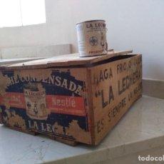 Coleccionismo: ANTIGUA CAJA DE LA LECHERA CON BOTE ORIGINAL. Lote 166835102