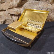 Coleccionismo: ANTIGUA TABAQUERA CON FORMA DE PIANO Y CAJA MUSICAL MARCA TOYO. Lote 204398258