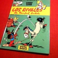 Cómics: LUCKY LUKE-LOS RIVALES DE PAINFUL GULCH.GRIJALBO.1991+REGALO CUENTO LUCKY LUKE. Lote 104621123