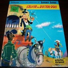 Cómics: LUCKY LUKE - L'ELIXIR DEL DOCTOR DOXI - GRIJALBO/DARGAUD - 1991 - EN CATALÁN. Lote 110156635