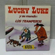 Cómics: LUCKY LUKE Y SU MUNDO. LOS TRAMPEROS. MORRIS. GRIJALBO. 1985.. Lote 117170079