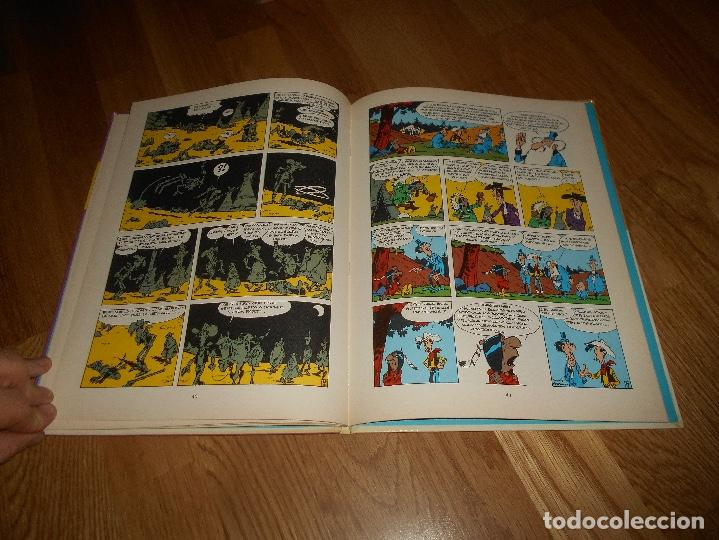 Cómics: LUCKY LUKE LAS COLINAS NEGRAS + REGALO EL HILO QUE CANTA LOS DOS 1º EDICION - Foto 7 - 141580802
