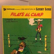 Cómics: LUCKY LUKE, FILATS AL CAMP, GRIJALBO-DARGAUD, EN CATALÀ. Lote 148166682