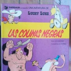 Cómics: LUCKY LUKE. LAS COLINAS NEGRAS. GRIJALBO. TAPA DURA. Lote 212395602