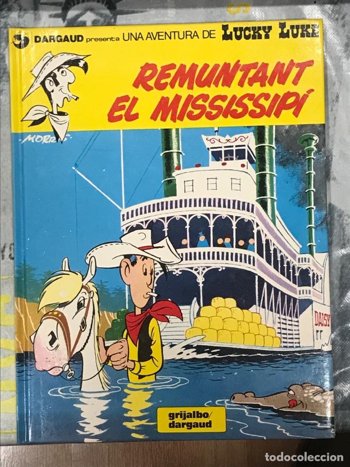 REMUNTANT EL MISSISSIPI DE LUCKY LUKE, GRIJALBO Nº9CATALÁN, TAPA DURA, IMPECABLE 1992 (Tebeos y Comics - Grijalbo - Lucky Luke)