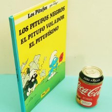 Cómics: TOMO CON LOS PITUFOS NEGROS, EL PITUFO VOLADOR Y EL PITUFISMO, GRIJALBO 1983 TAPA DURA 84 PAG. Lote 220860507