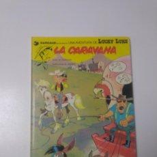 Cómics: LUCKY LUKE NÚMERO 12 LA CARAVANA 1982 GRIJALBO-DARGAUD. Lote 229609025