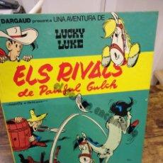 Cómics: LUCKY LUKE. ELS RIVALS DE PAINFUL GULCH. CATALÀ. GRIJALBO. Lote 234711415