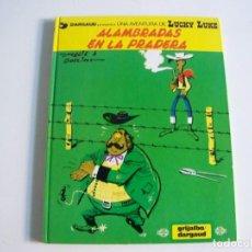 Cómics: GRIJALBO LUCKY LUKE 31 ALAMBRADAS EN LA PRADERA. Lote 242841045