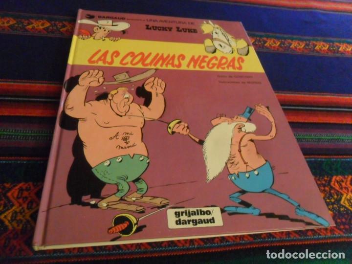 Cómics: LUCKY LUKE NºS 33 RIVALES DE PAINFUL GULCH. GRIJALBO AÑOS 80. REGALO Nº 11 LAS COLINAS NEGRAS. - Foto 2 - 30350539