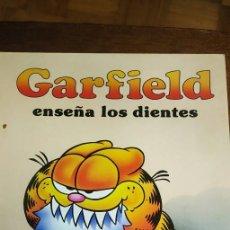 Cómics: GARFIELD ENSEÑA LOS DIENTES . TAPA DURA.. Lote 248085305
