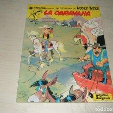 Cómics: COMIC LUCKY LUKE LA CARAVANA - DARGAUD - GRIJALBO - 1985 - TAPA BLANDA. Lote 260726060