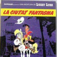 Cómics: LUCKY LUKE - LA CIUTAT FANTASMA - TAPA DURA - COMIC EN CATALAN. Lote 262680635