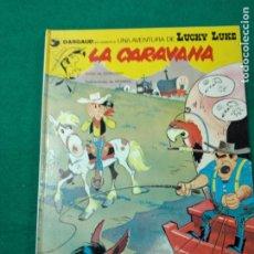Cómics: UNA AVENTURA DE LUCKY LUKE. LA CARAVANA. GOSCINNY / MORRIS. EDICIONES JUNIOR 1979. Lote 268744429