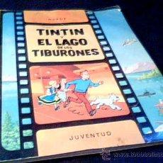 Cómics: TINTIN Y EL LAGO DE LOS TIBURONES. HERGE. EDITORIAL JUVENTUD, 1983. RUSTICA.. Lote 27529902