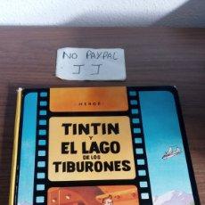 Cómics: HERGE TINTIN Y EL LAGO DE LOS TIBURONES JUVENTUD PRIMERA EDICIÓN 1974 VER FOTOS ESTADO LOMO,. Lote 287822103