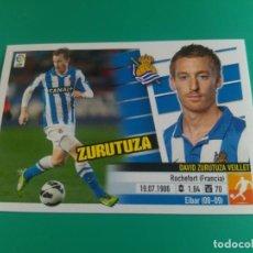 Cromos de Fútbol: 11 ZURUTUZA - REAL SOCIEDAD - CROMO EDICIONES ESTE 2013-14 - 13/14 (NUEVO). Lote 152058082