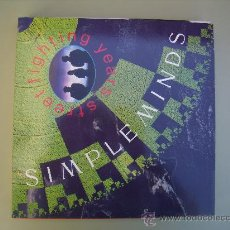 Discos de vinilo: SIMPLE MINDS - STREET FIGHTER. Lote 26252661