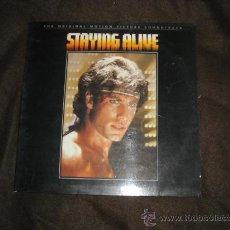 Discos de vinilo: STAYING ALIVE LP BANDA SONORA ORIGINAL J.TRAVOLTA..STALLONE..BEE GEES PORTADA DOBLE. Lote 26618306