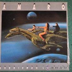 Discos de vinilo: AMARO - MORDIENDO LA VIDA (VINILO AZUL). Lote 32173784