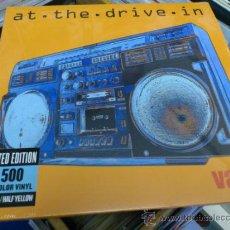 Discos de vinilo: AT THE DRIVE-IN VAYA VINILO COLOR DE DIEZ PULGADAS MUY RARO ED LIMITADA 1500 COPIAS . Lote 33454023