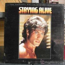 Discos de vinilo: STAYING ALIVE - BANDA SONORA - RSO 1983. Lote 35946594