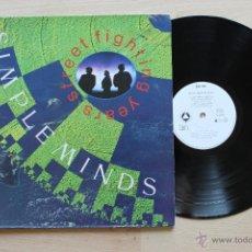 Discos de vinilo: SIMPLE MINDS STREET FIGHTING YEARS LP PORTADA ABIERTA GATEFOLD COVER. Lote 43097439