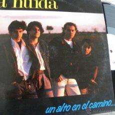Discos de vinilo: LA HUIDA -UN ALTO EN EL CAMINO -LP 1991. Lote 49015210