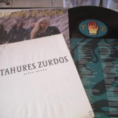 Discos de vinilo: TAHURES ZURDOS LP NIEVE NEGRA EMI CON 5 HOJAS DE PRESENTACIÓN ESPAÑA 1991. Lote 50104821
